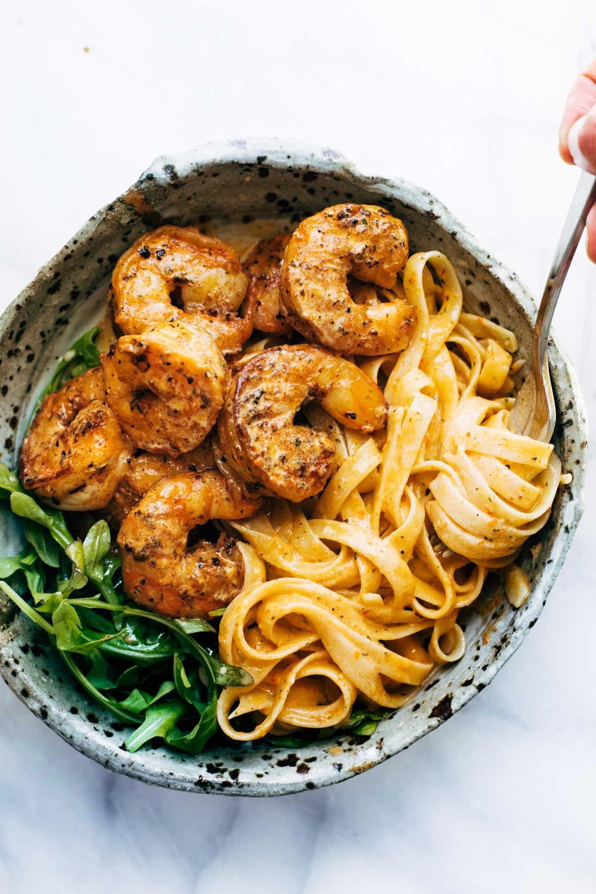 Red Pepper Fettuccine with Shrimp! It's got quick, pan-fried shrimp, creamy noodles, and red pepper / garlic / butter / lemon-ish sauce vibes. Perfect quick and easy dinner! |