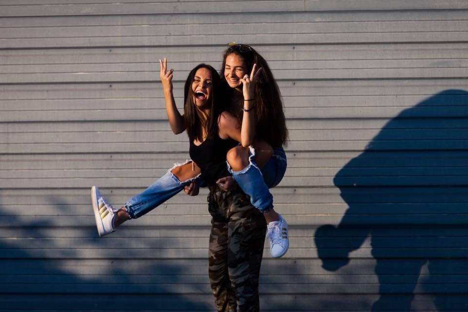 Give Your Best Friend A Piggy Back Ride For A Fresh Pose Idea