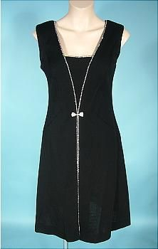 Early 1970's black poly dress trimmed in sparkling rhinestones with hot pants underneath.