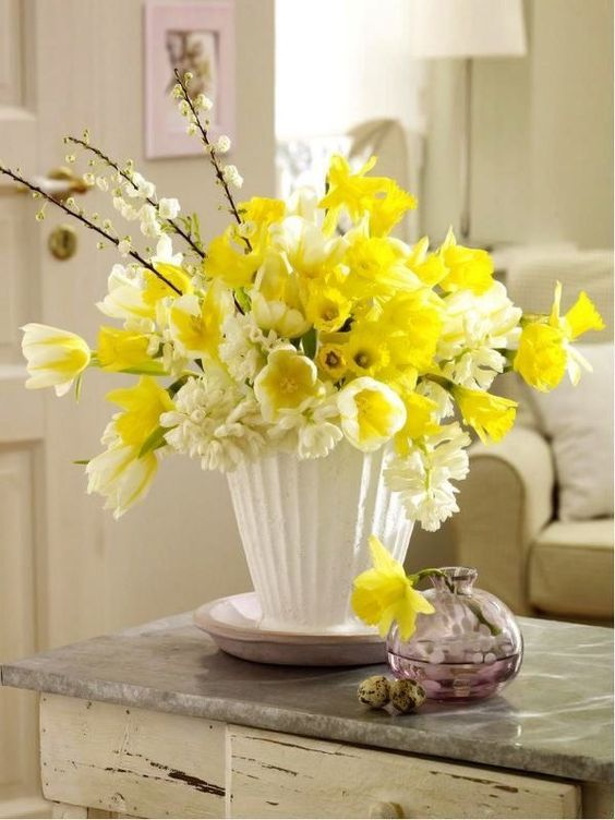 Spring Centerpiece Of Daffodils White And Yellow Tulips And White