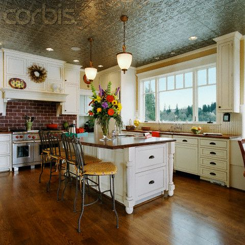 Off White Kitchen With Pressed Tin Ceiling Red Brick Accents