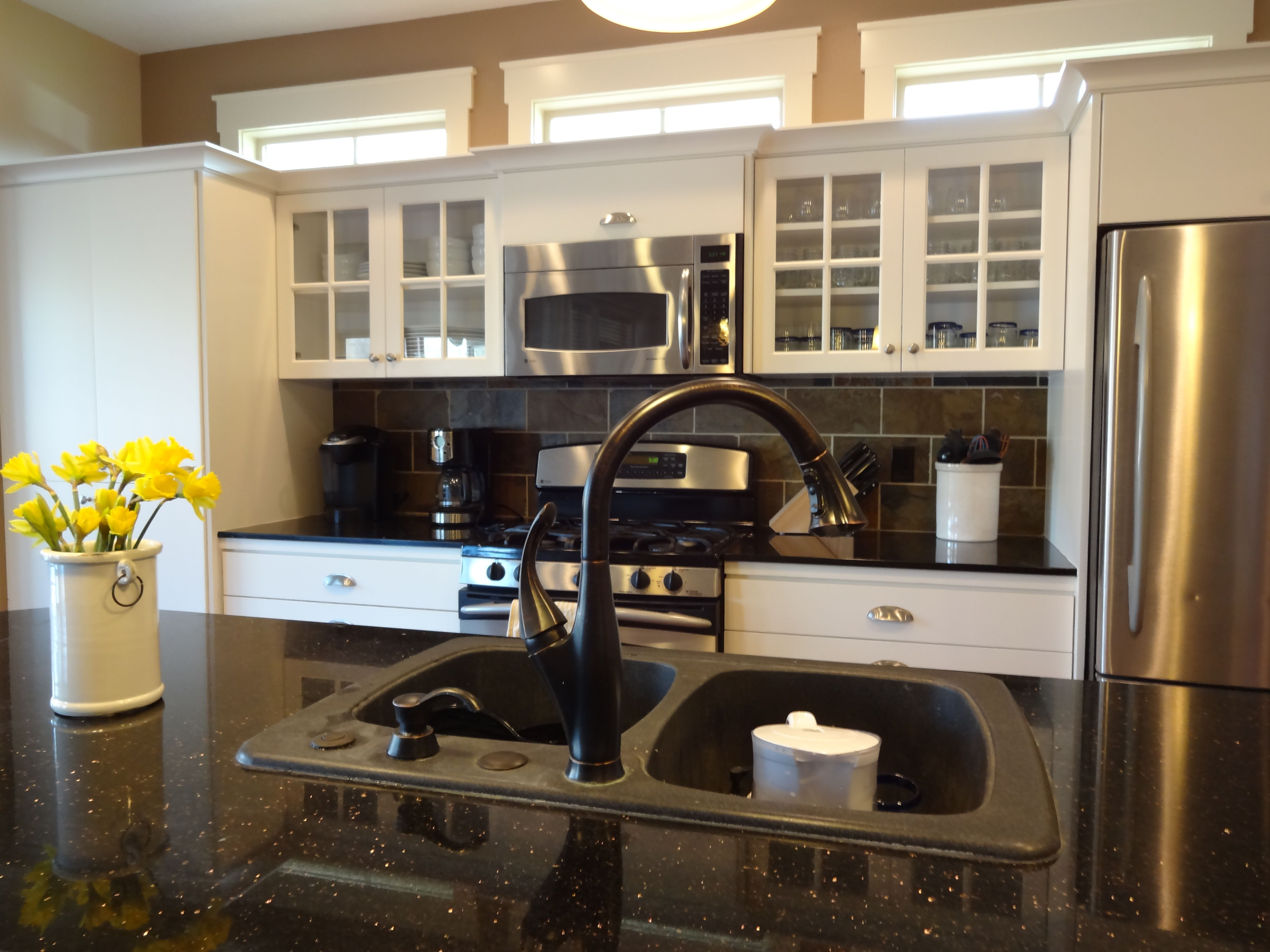 Refinished kitchen cabinets Dover White to match trim in ...