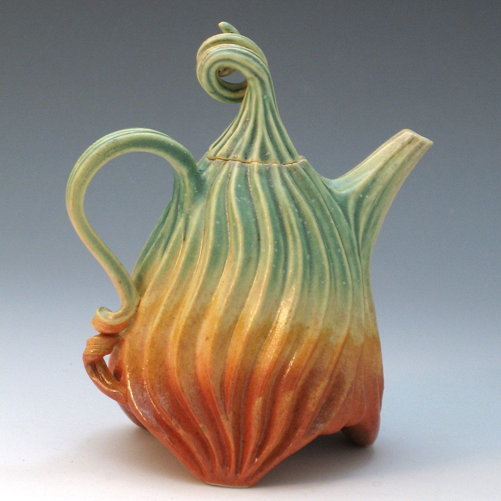 Porcelain teapot with carved grooves in green, tan and orange glazes.  Isn't this just funky?