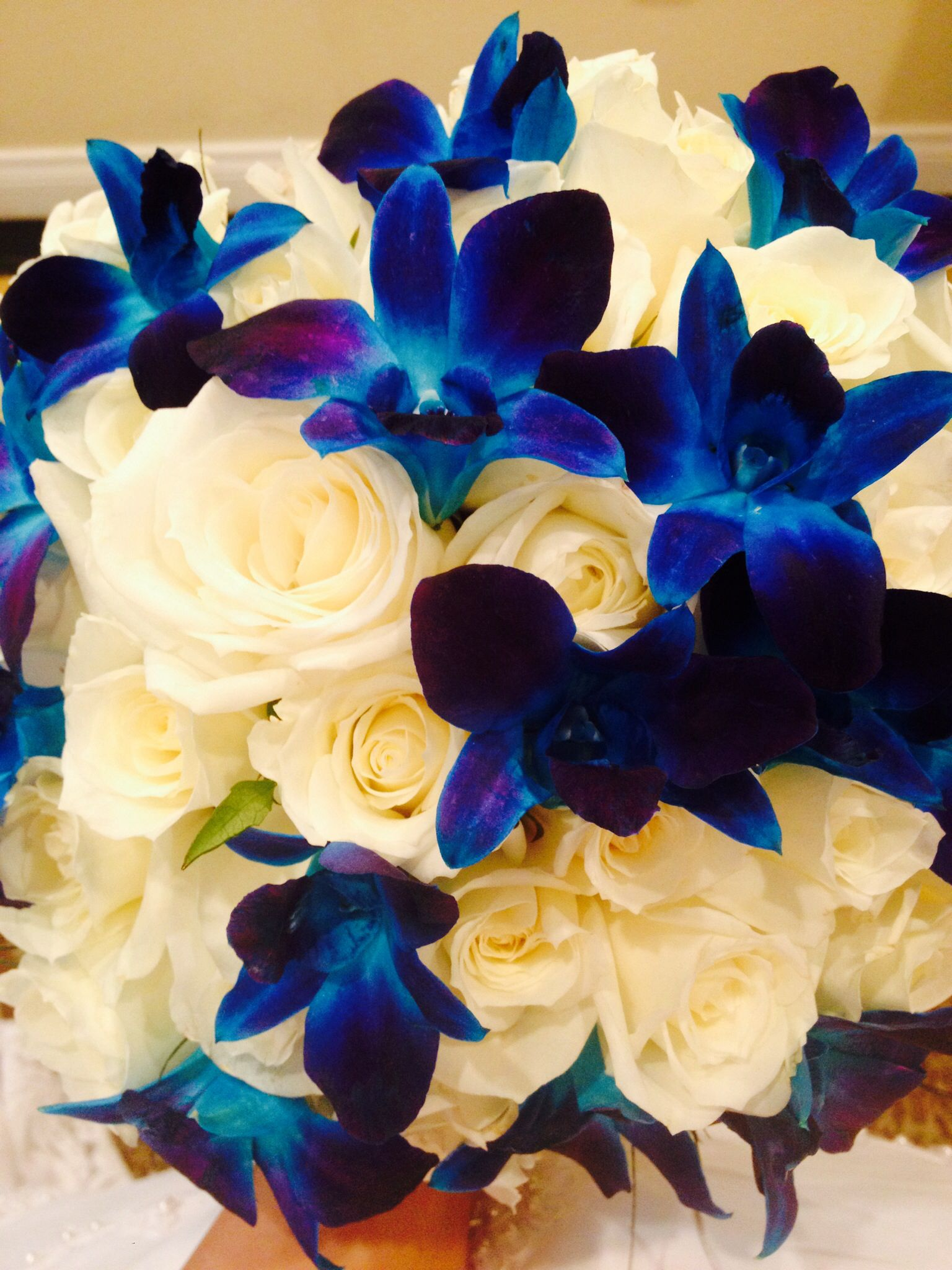 Wedding bouquet white roses blue dendrobium orchids flowers