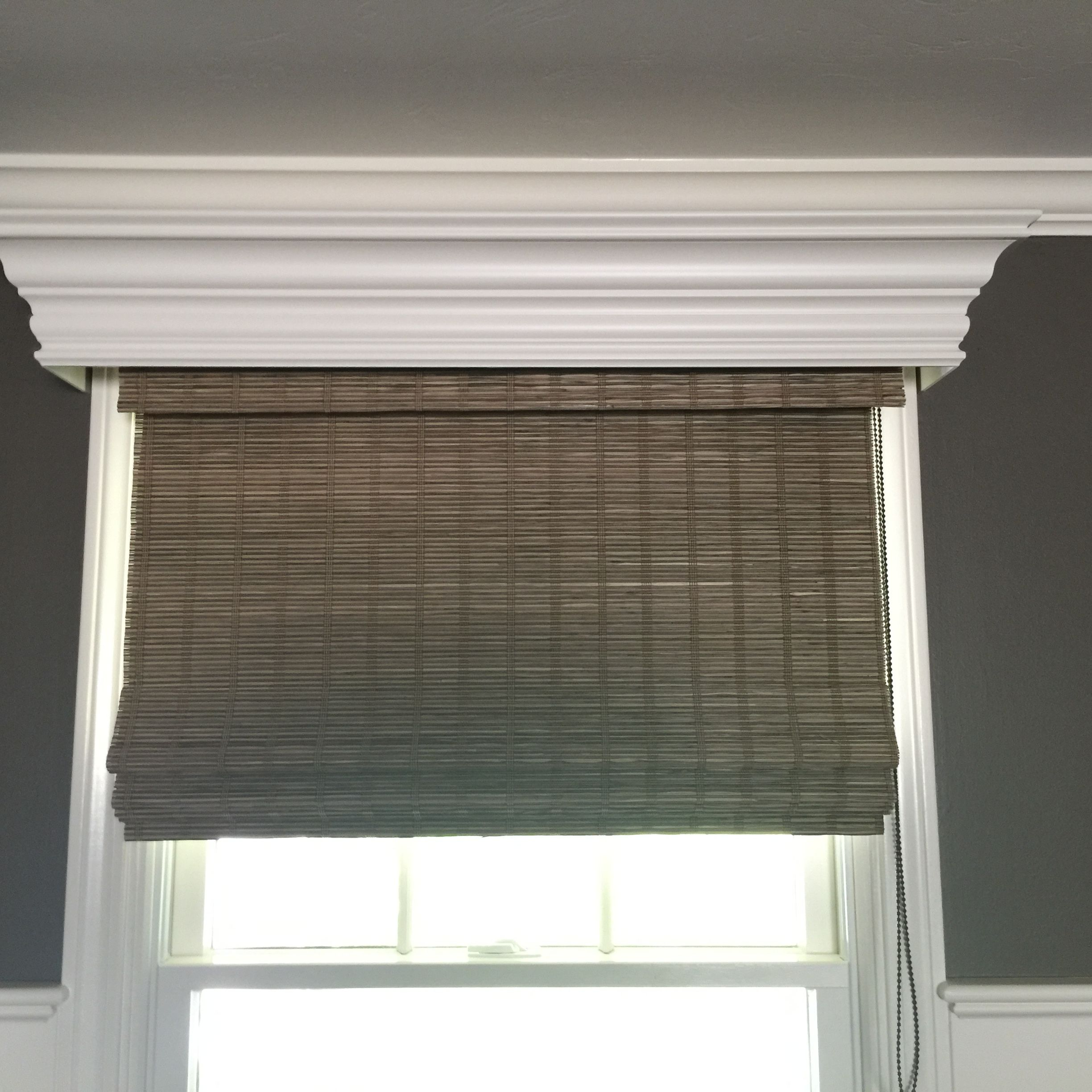 Provenance Woven Wood Shade with a Parkland Wood Cornice by Hunter