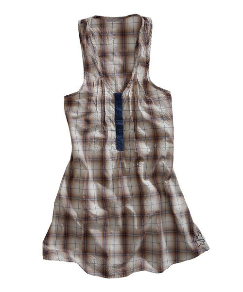 Lend a laid-back vibe to any wardrobe with the addition of this plaid tunic. Boasting a racerback shape, subtle pleats and a denim accent up front, it provides a shoulder-baring look with loads of stylish appeal. 100% cottonMachine wash; dry flatImported