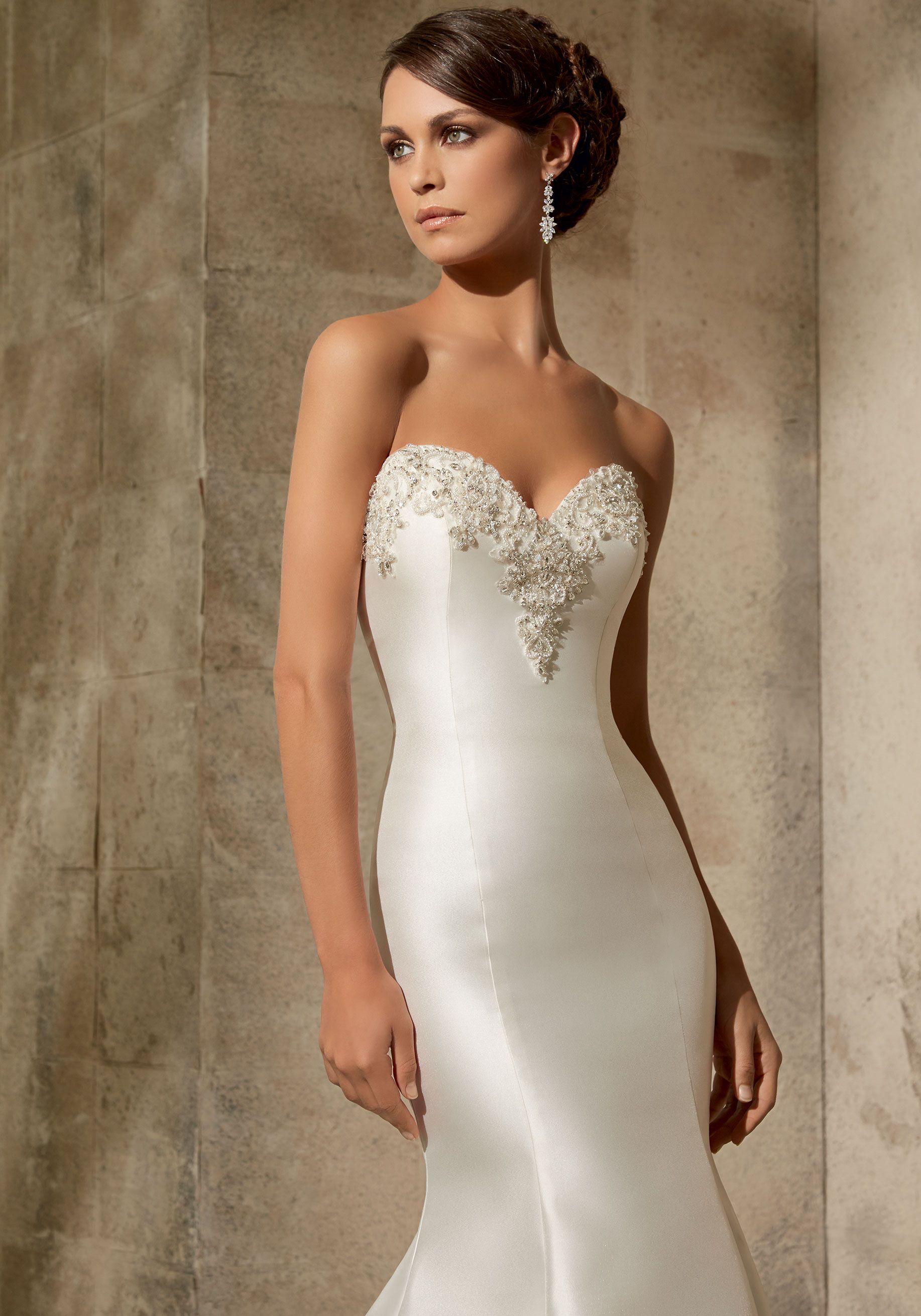 Sleek and modern, this Satin Bridal Dress features a deep sweetheart ...