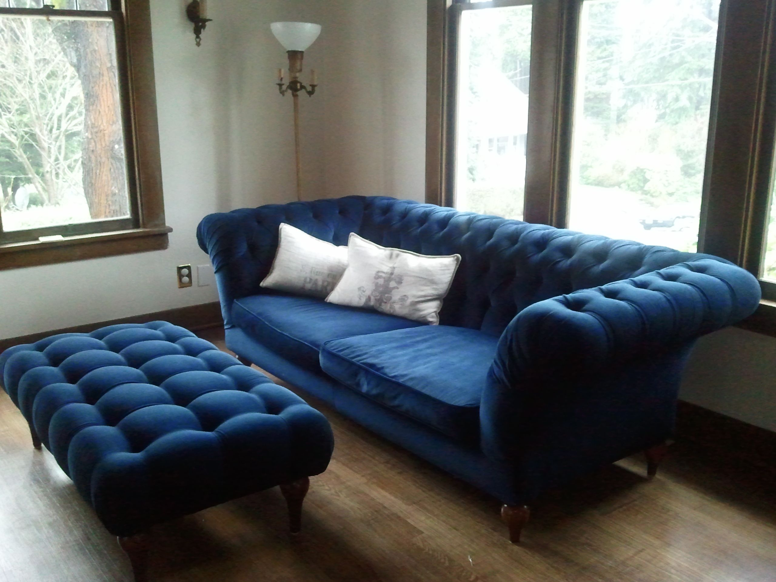 Blue tufted ottoman it is gorgeous midnight blue for Blue living room chairs