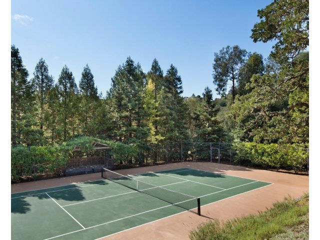 The Owners Managed To Squeeze In A Tennis Court On Their 8 Acre Estate Woodside Ca Coldwell Banker Residential Brok Tennis Court Backyard Tennis Court Tennis