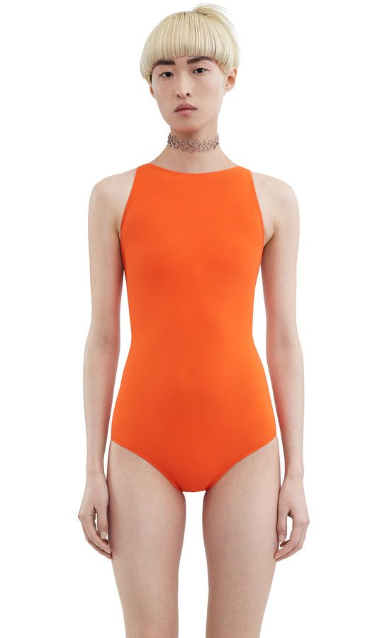 Halla orange swimsuit features an Olympic style front and open back ...