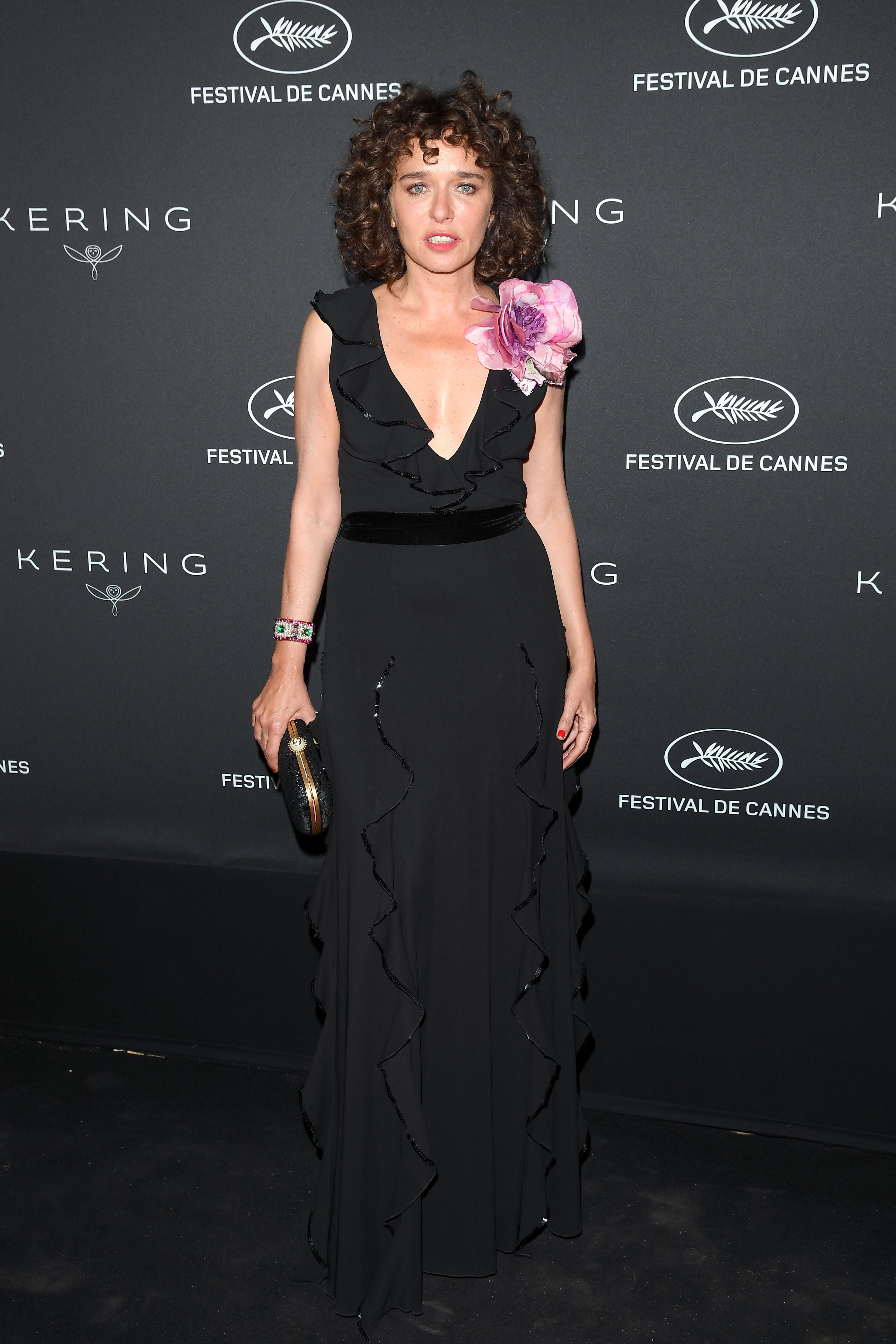4829d451d Valeria Golino in a Gucci Cruise 2017 gown with ruffles and sequin details,  silk floral broche, and black clutch with pearl closure at the  KeringxCannes ...