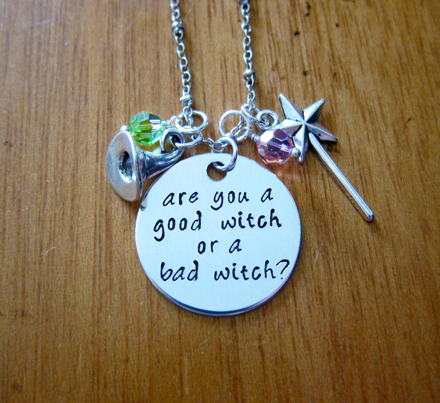 Good Witch/Bad Witch Halloween Necklace. Are you a good witch or a bad witch? Witch Hat Magic Wand  Crystals. Silver colored. by WithLoveFromOC (item: 2015826126)