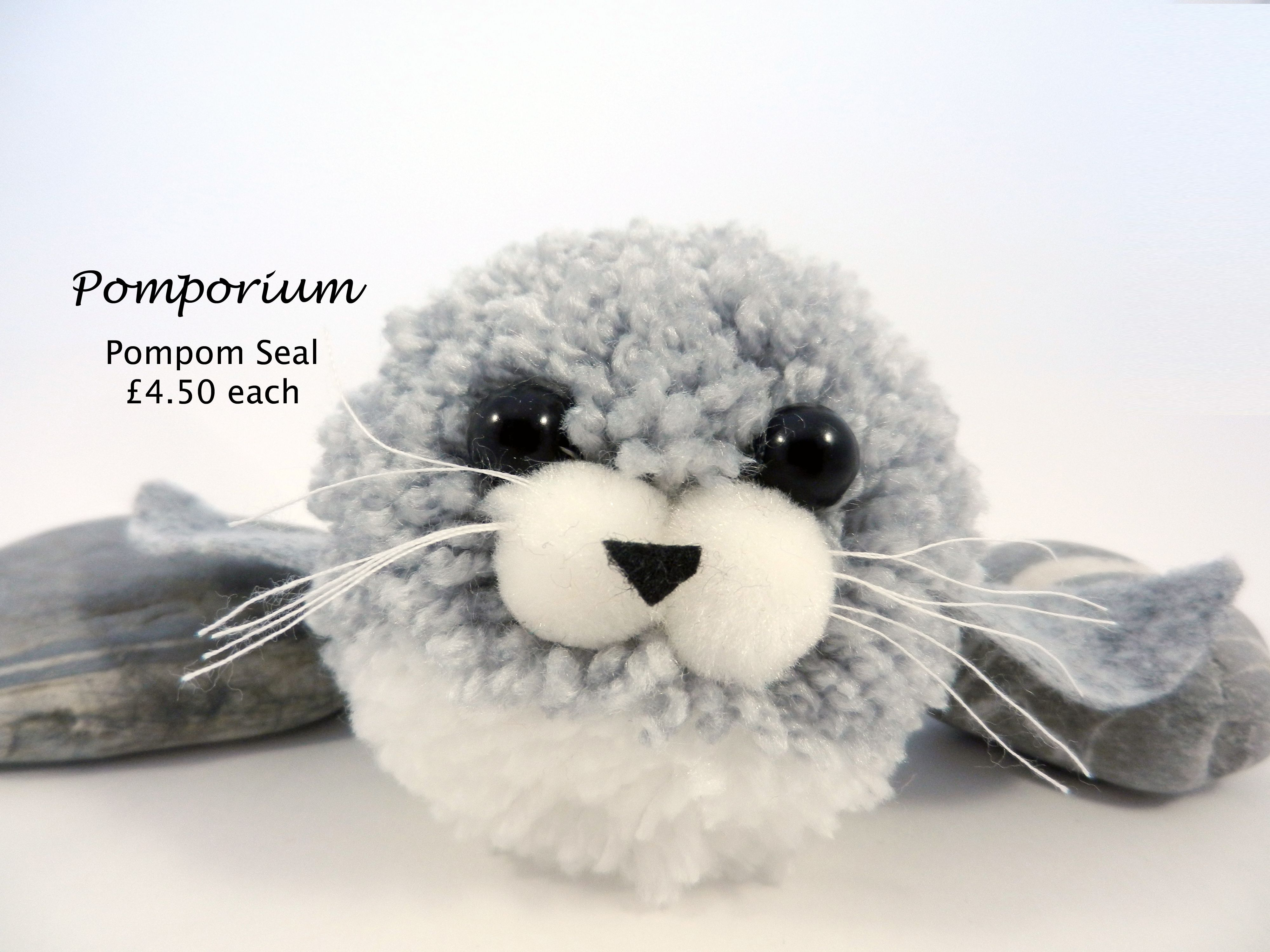 An adorable little pompom seal. Made to order. See more @ www.facebook.com/pomporium