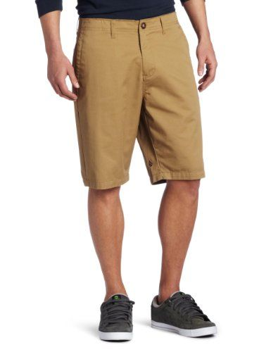 """For men, there is a fine line one must walk when wearing shorts. Too baggy and long, you look like you frequent jam band concerts. Too short and tight, you look like your wife dresses you from a Lands End catalog. These, as Goldilocks would say, are """"just right."""" (Volcom Men's Fairmondo Short)"""