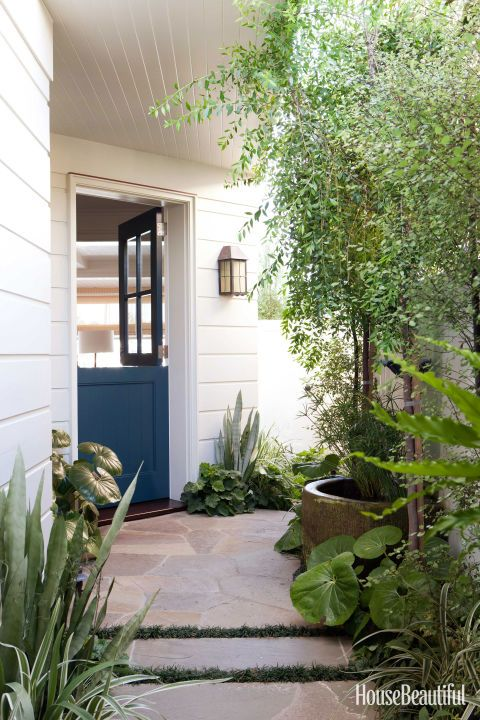 The Dutch door was added to take advantage of sea breezes. It's painted Benjamin Moore Pacific Ocean Blue, a color that carries through the house.
