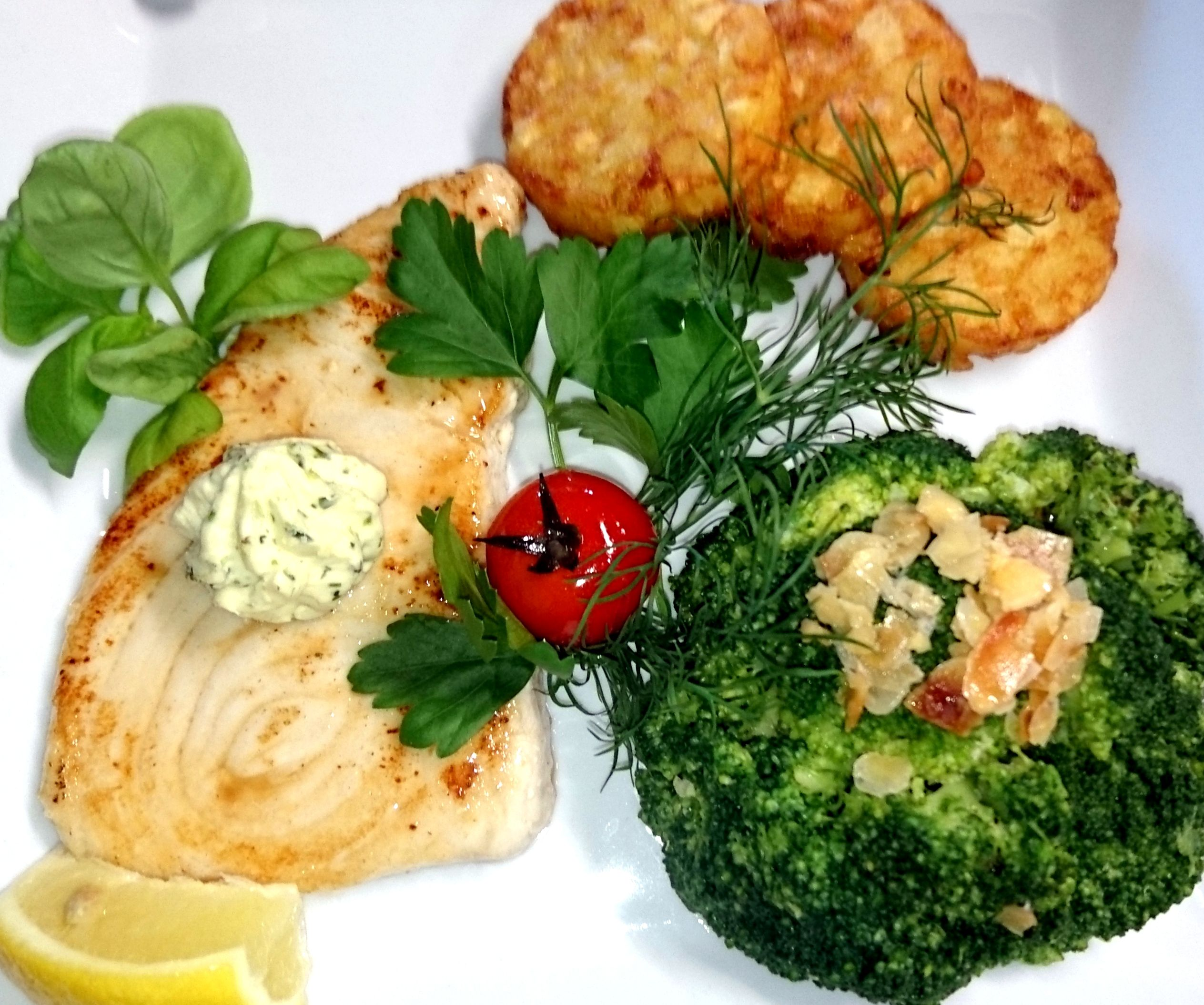 Swordfish fillet fried in herb butter, almond broccoli and hash Browns