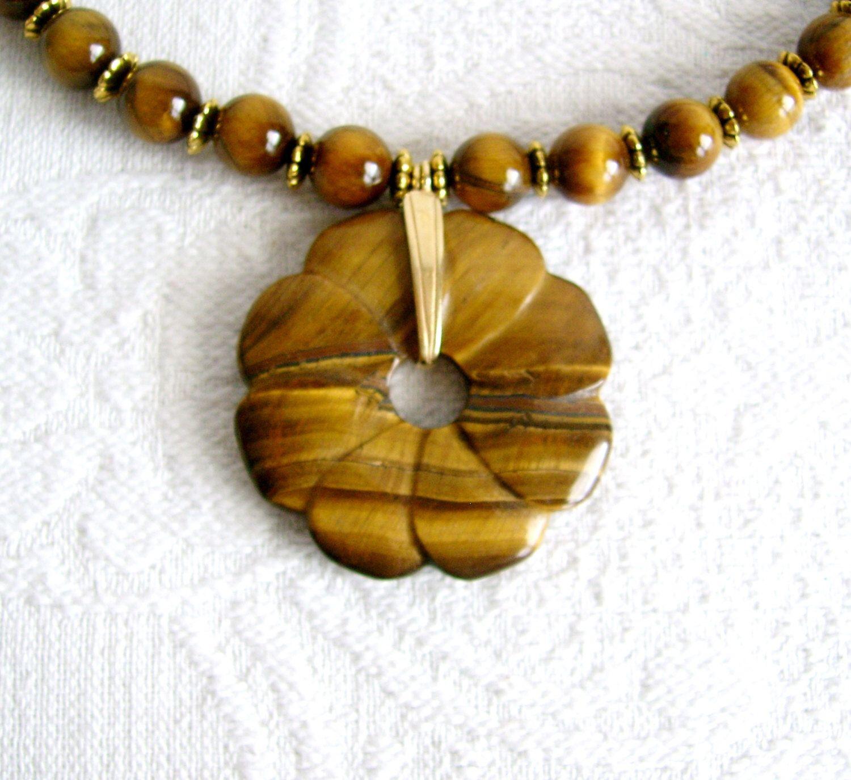 Tigereye Flower Donut Necklace by JeweledFibers on Etsy https://www.etsy.com/listing/150145358/tigereye-flower-donut-necklace