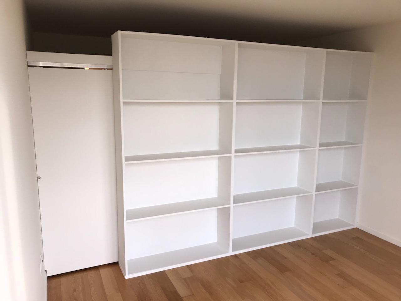 Freestanding Bookcase Wall With Sliding Door Call Us For All Your Custom Room Partition And Storage Inq Bookcase Wall Room Divider Bookcase Free Standing Wall