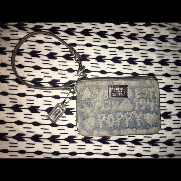 Coach Poppy wristlet Beautiful little coach wristlet. Perfect for on the go. It's a blue jean material with gorgeous stitching. The zipper works perfectly. Nothing wrong with it just slight stains in the inside from money. Coach Bags Clutches & Wristlets
