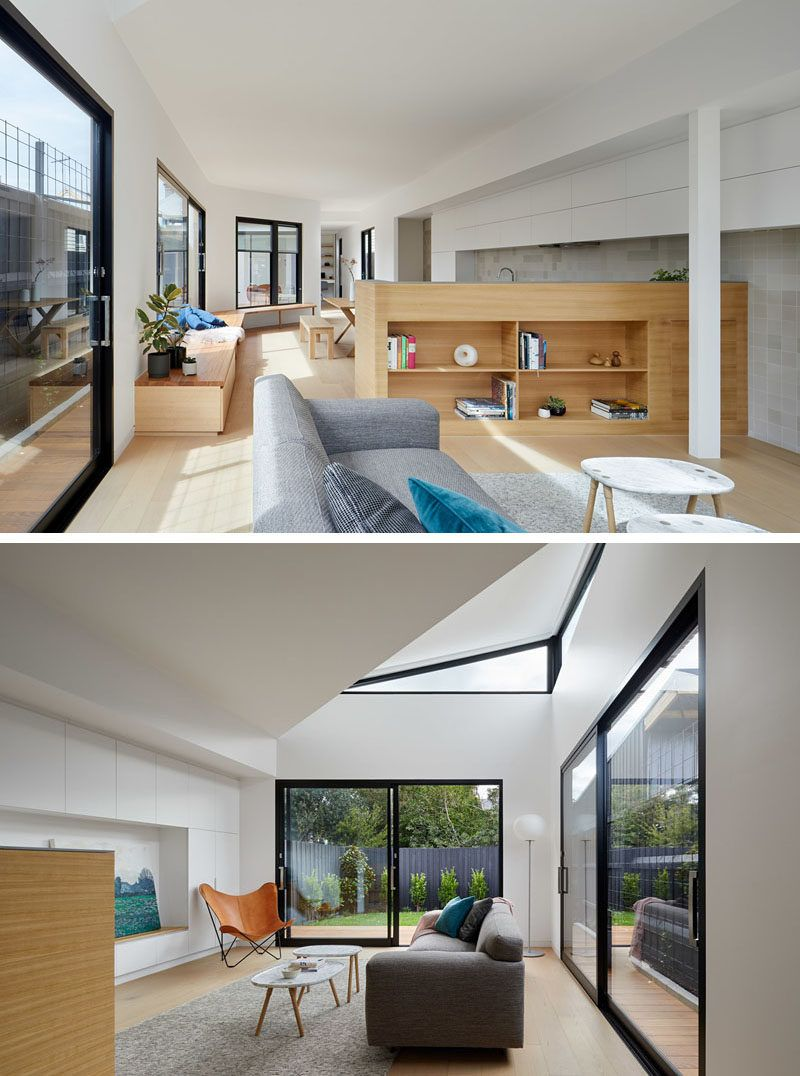 Living Room Ideas - In this modern house extension, a low wood wall between the kitchen and living room provides open shelving for displaying decor. The white kitchen cabinets continue through to the living room too, and incorporate a built-in bench. #HouseExtension #LivingRoom #InteriorDesign