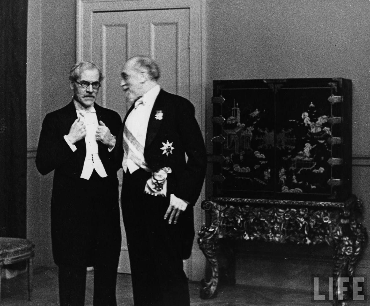L R Prime Minister Ramsay Macdonald Of Great Britain And Governor Of The Bank Of England Montague Norman Attending Diplomatic Reception At Austrian Legation