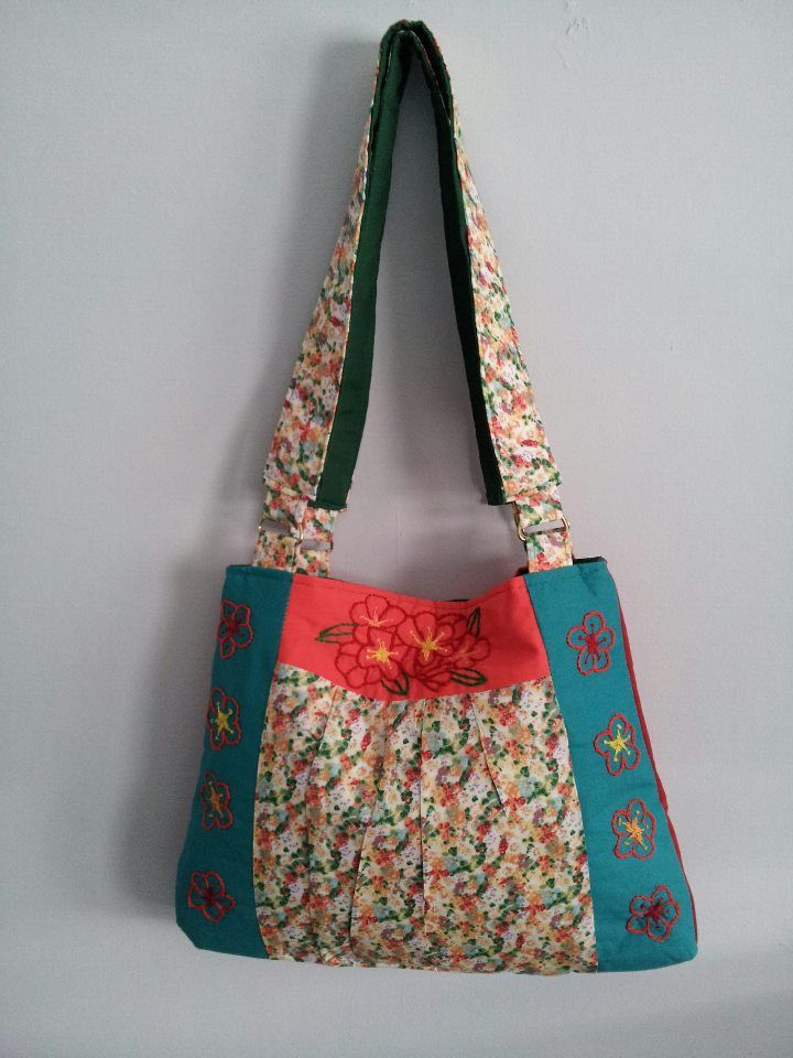 Handbag has flowers embroidery on top and sides of bag. This is one of a kind bag