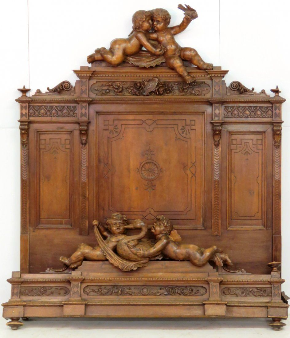 Antique italian figural carved bed w cherubs on