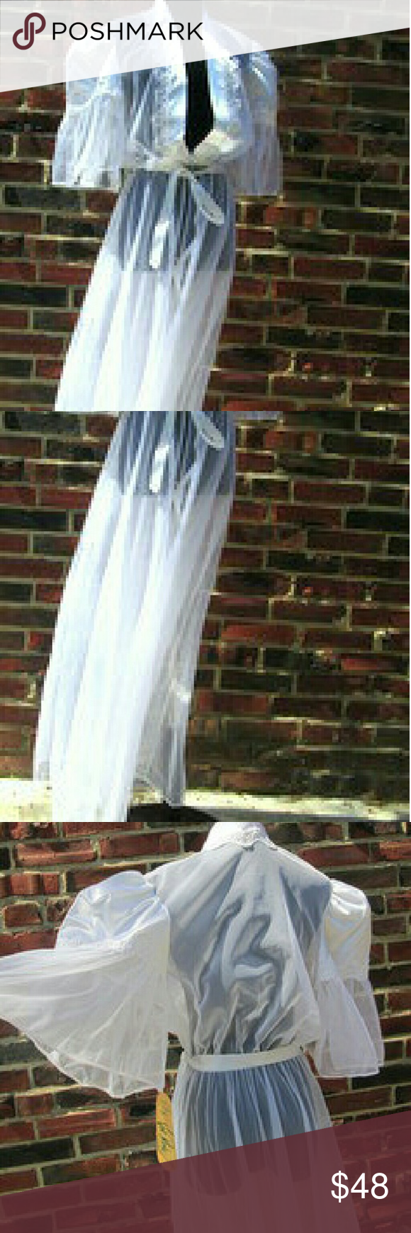 """Vintage White Sheer Robe with Lace Size Large Vintage White Sheer Robe.  Lace and Sheer White Robe. Very Beautiful. New With Tags. Wonderful Condition...No Flaws Label: Val Mode Made in USA Size Large...will fit size med as well Silky Nylon and Sheer and Lace Inticate Sleeves: 18""""  Bell Shaped  Bust: 38"""" - 42"""" Elastic empire Waist Front 1 Pearl Button Closure and Satiny Belt Total Length: 58"""" Stunning ! Vintage  Intimates & Sleepwear Robes"""