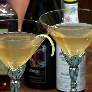 Ingredients 4 ounces Absolut Citron, Ketel One Citronelle, or comparable best-quality citrus vodka2 ounces Sambuca (more, if you prefer a stronger licorice flavor)6 dashes orange bitters (Angostura, Fee Brothers and Stirrings are good brands)Juice of one lemonIce6 espresso beans for garnish (optional)