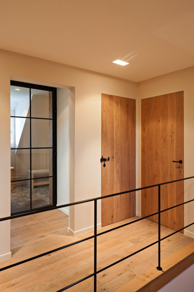 Hall with wooden floor and steel balustrade