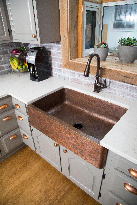 Copper farmhouse kitchen sink looks beautiful with darker