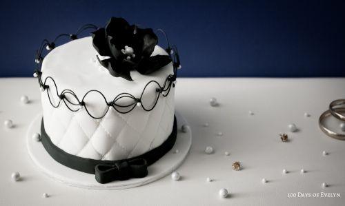 Chanel Cake - quilted white fondant, oriental stringwork, black flower and pearls from 100 Days of Evelyn