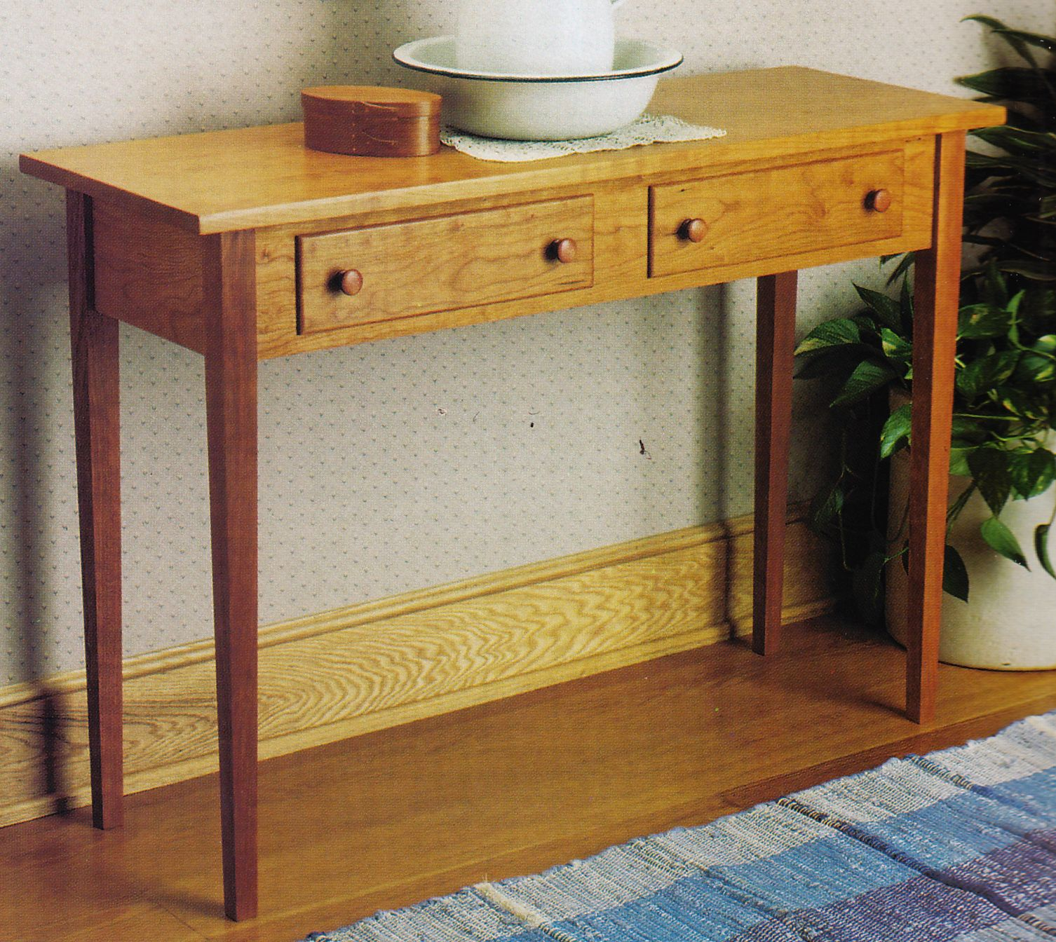 Shaker hall table from Woodsmith Custom Woodworking's American Style: Shaker, Mission & Country Projects. If interested, please ask for a free quote on this item. We'd love to build it for you.