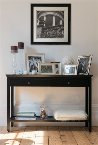 A stylish and dramtaic painted console table in a refined style
