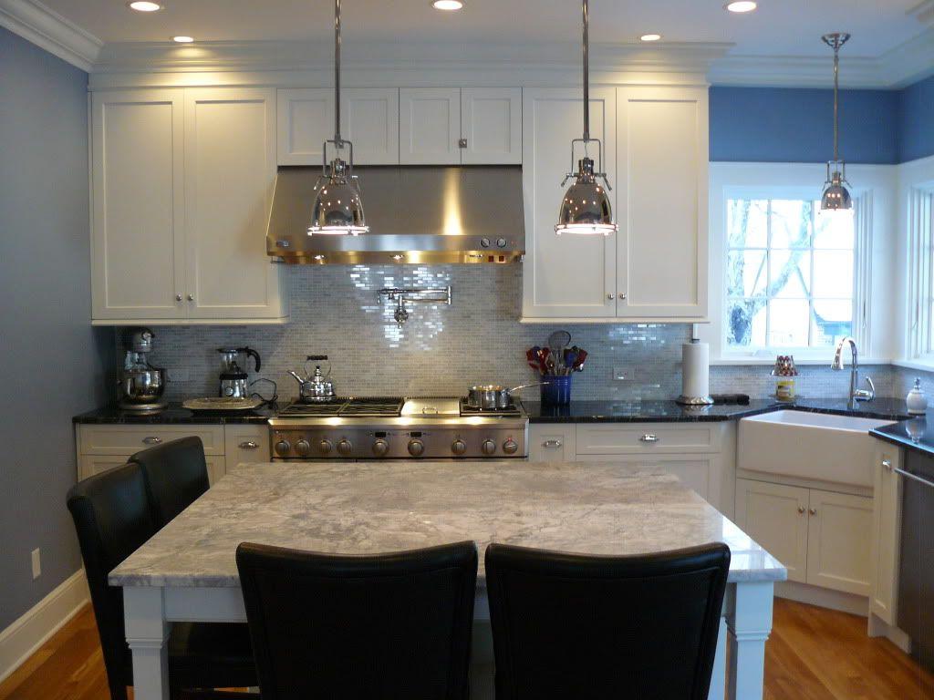 super white granite island black granite surround carrara marble super white granite island black granite surround carrara marble backsplash white cabinets