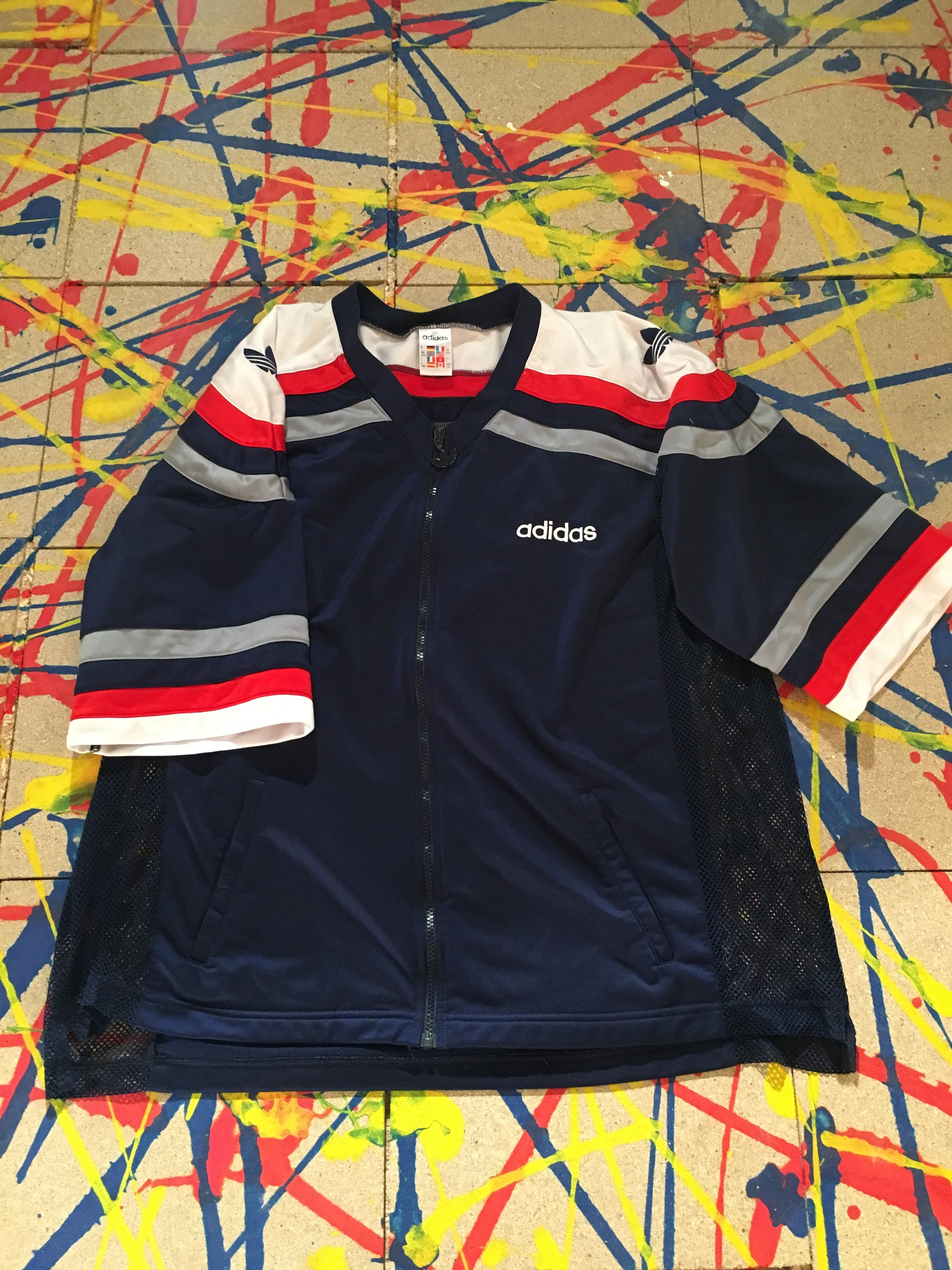 1cbe4e29eabd 90s VINTAGE ADIDAS SHORT SLEEVE TRACK TOP. FROM THE LEGENDARY POPPERS  SERIES. 9 10 CONDITION