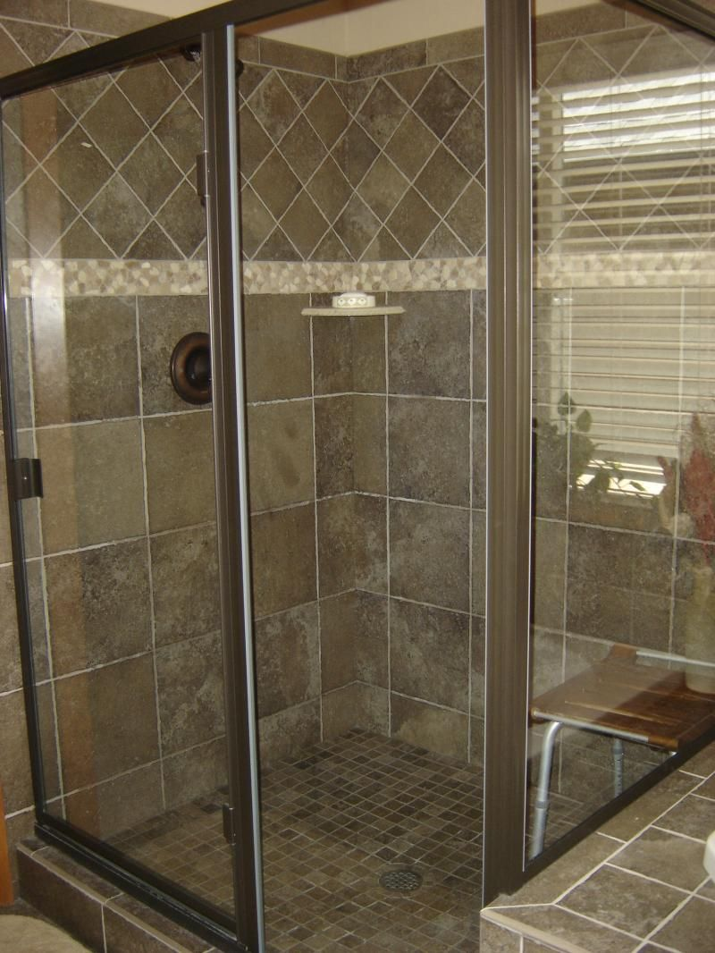 All of these tiles look so familiar one family mostly 2x2 love this color for floor tile one family mostly mosaic on floor on wall of the way up pebble border tile on point above and finished with a bullnose dailygadgetfo Image collections