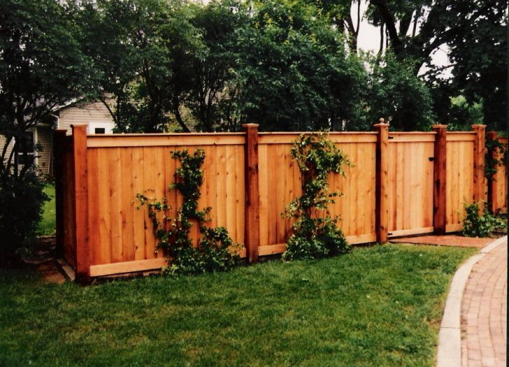 Wood Fence Ideas Tight Slat With Top And Bottom Border Board And Cap Board On Top Capped Higher Posts Lend A More Fence Design Wood Fence Design Wood Fence