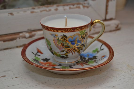 Candle in an oriental tea cup $12