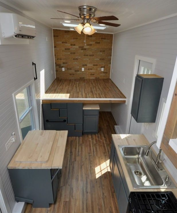 Inglewood by Tiny House Building Company is part of Home Accents Faux Brick - From Tiny House Building Company is the 36foot Inglewood  The gooseneck tiny home features an 8foot office space with builtin desk over the gooseneck