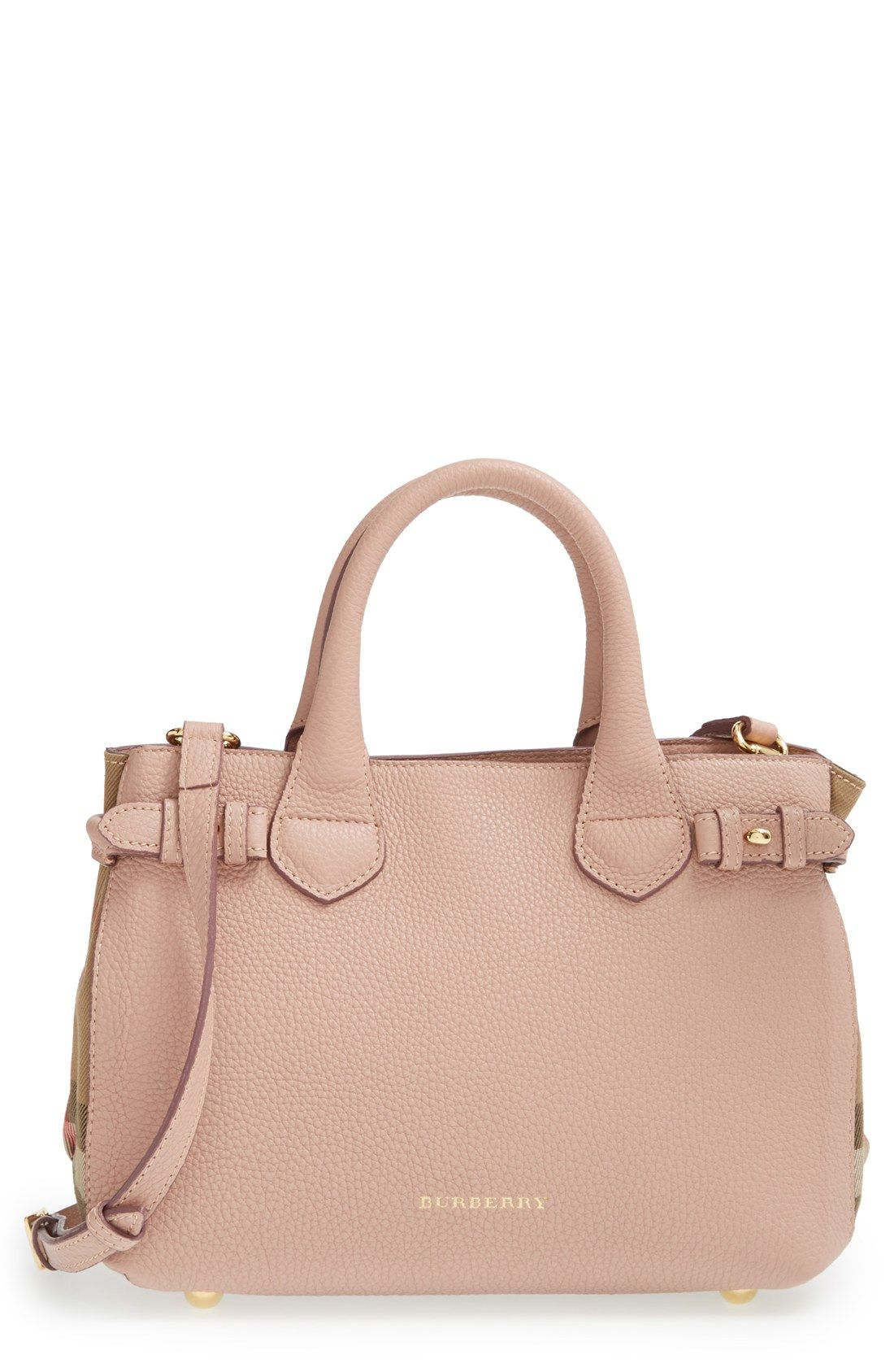 99e8f4e59dc The side buckle fastenings add a bit of equestrian-inspired style to this  stunning compact Burberry tote.