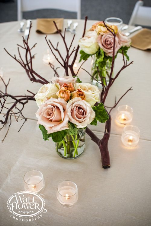 Manzanita branch centerpiece with arrangements of roses, ranunculus and scented geranium leaves by Jen's Blossoms
