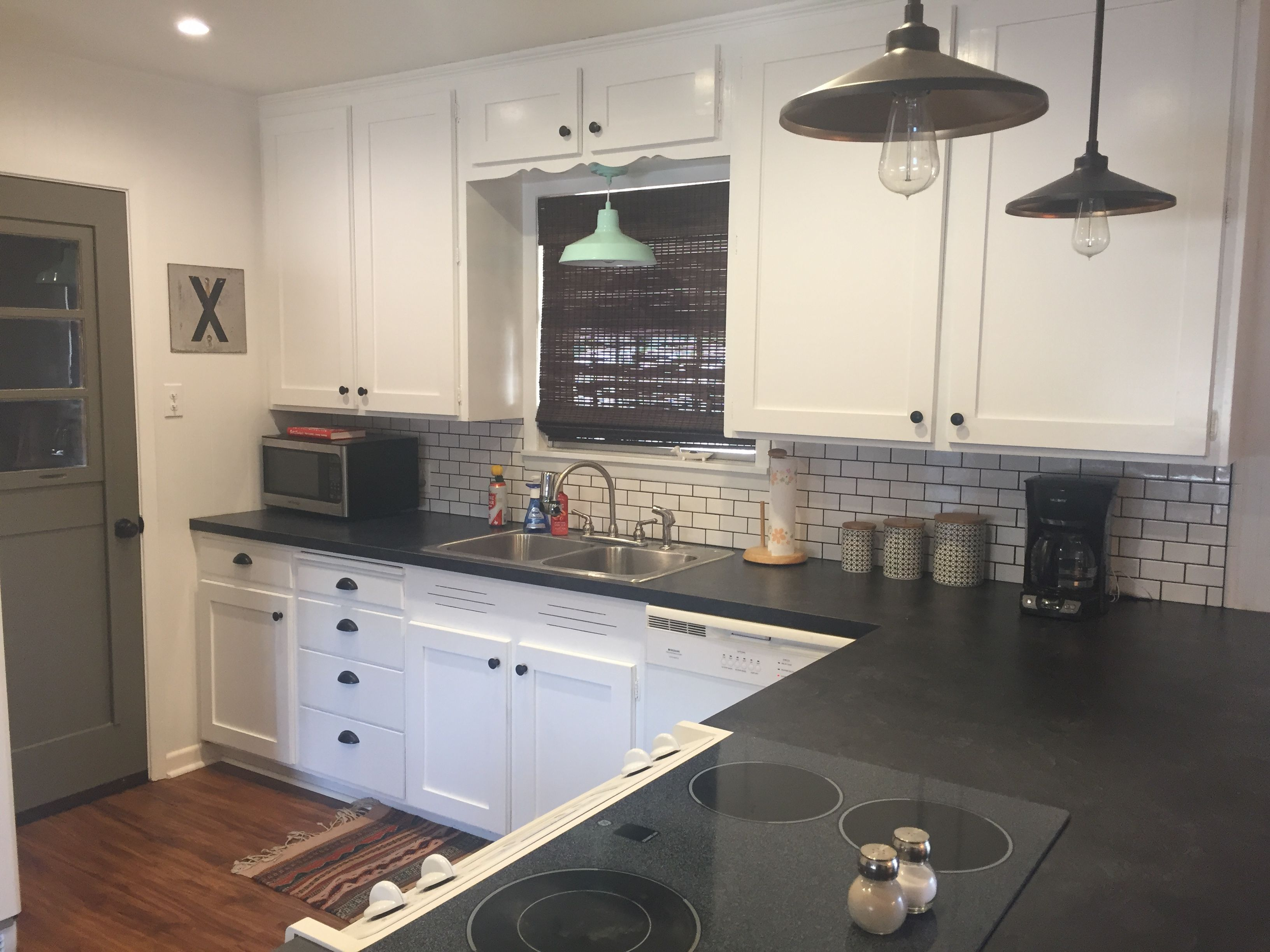 Subway Tile Kitchen Countertops Formica Basalt Slate with Scovato finish. Mini subway tiles and black grout.