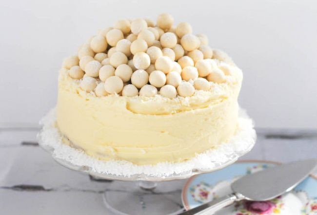 Show stopping white chocolate cake decorated with a tower of white maltesers.