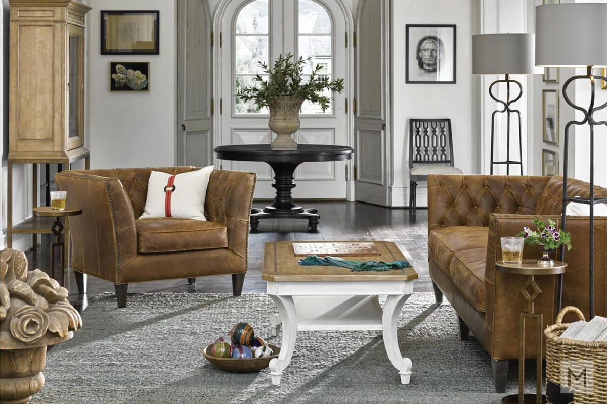 Duncan accent chair featuring button tufted back and