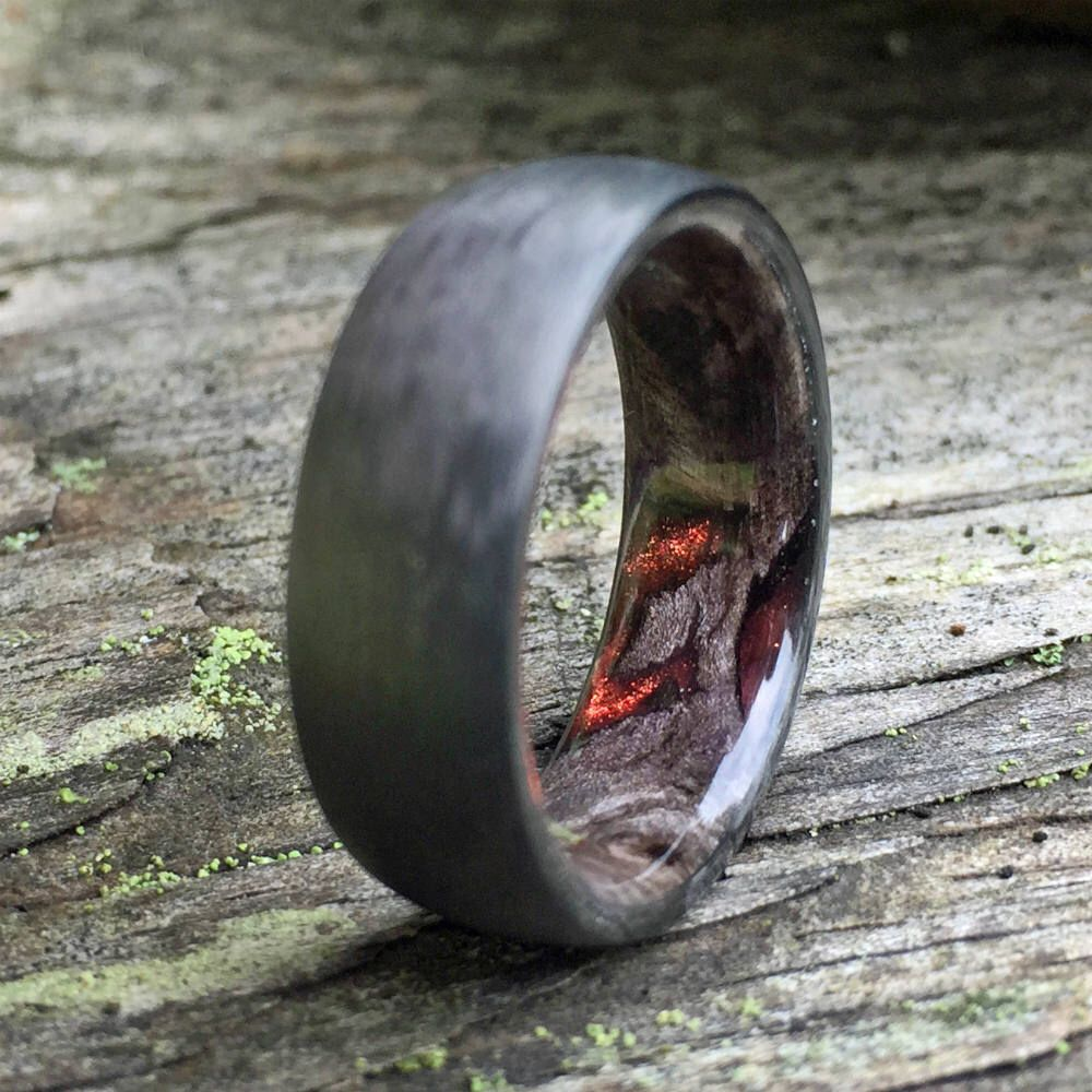 Handmade custom ring made with Stainless Steel and American Wallnut wood
