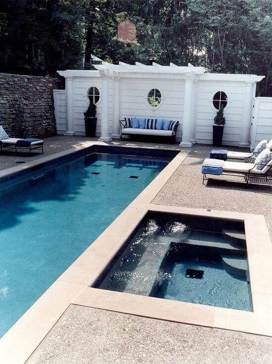 By Going With A Swimming Pool With Jacuzzi Design You Can Enjoy Your Yard All Year Long So Decide The Ki Swimming Pool Designs Backyard Pool Lap Pool Designs
