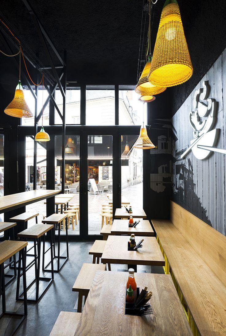 A Black And Yellow Restaurant Design Design Interieur Restaurant