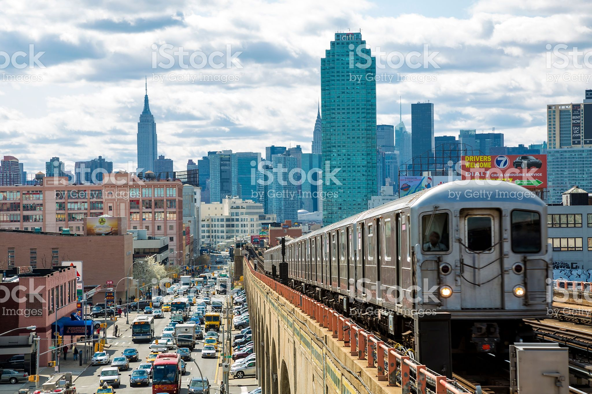 Train Approaching Elevated Subway Station In Queens New York
