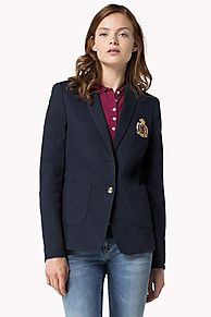 This preppy slim-fit blazer is made from a mid-weight cotton pique with jut enough stretch for a sophisticated look and ultimate comfort. Short blazer that comes to the hips. The tailored waistline flatters the feminine silhouette. Single-breasted styling with oversized patch pockets at the hips. Fully constructed and lined. Tommy Hilfiger logo crest on the chest, tag on the cuff.<br/><br/>Our model is 1.76m and is wearing a size S Tommy Hilfiger blazer.